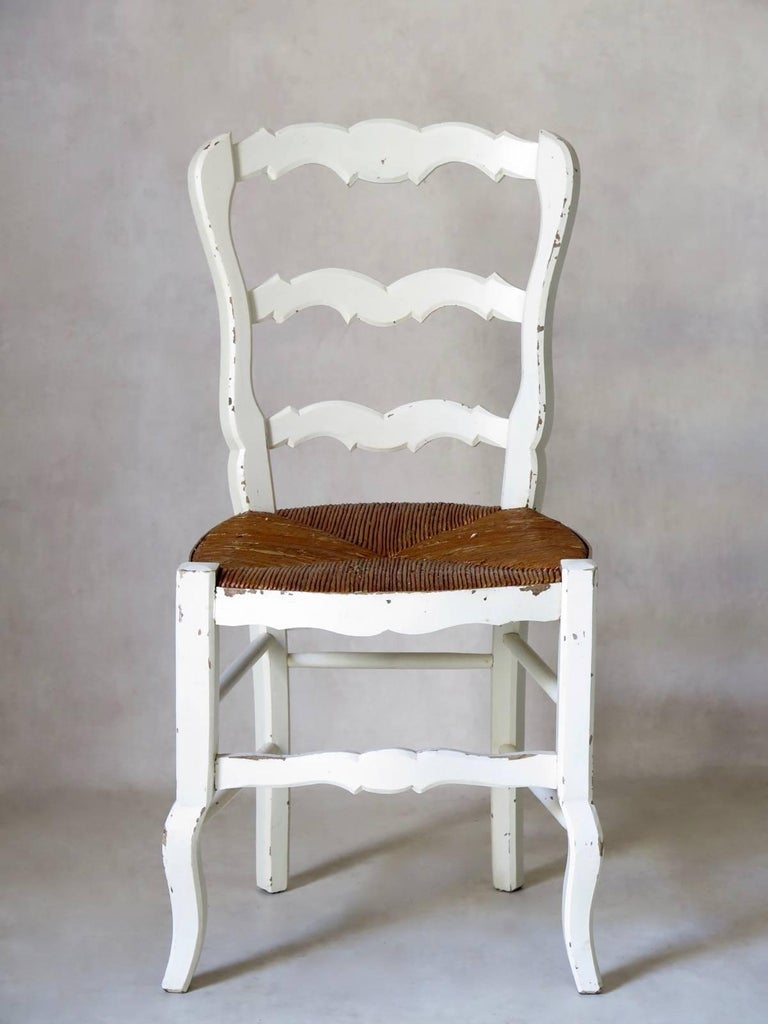 Charming set of six rustic, Provençal dining chairs of painted beechwood, with rush seats.