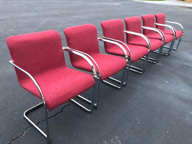 Set of six raspberry and chrome dining or office chairs. Heavy and solid construction make up these sexy 1970s style chairs. These cantilever chairs are in the style of Ludwig Mies van der Rohe. Chrome and upholstery are in very good condition.
