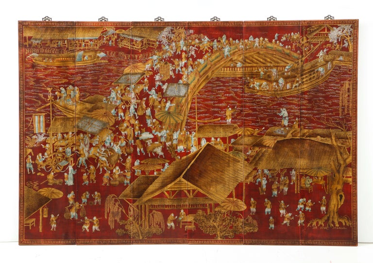 A set of six chinoiserie panels lacquered in a deep red with accents of gold and teal blue. This work of art depicts a lively scene and intricate detail. Each panel could stand on its own - but together, they make up story. These would be a great