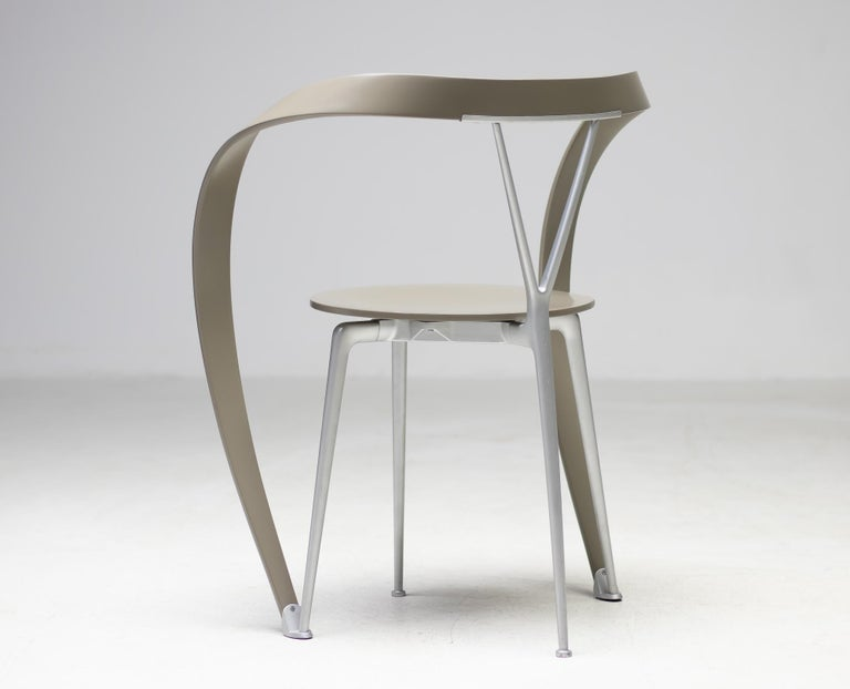 Andrea Branzi designed these chairs for Cassina in the early 1990s and they instantly became a Classic. Known as Revers chairs, they look like sculptural works of art. The grey painted beech seats and bent armrest are supported by an elegant