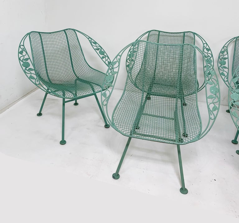 A set of six Russell Woodard Sculptura patio armchairs, ca. 1950s, in the uncommon Chantilly Rose edition. The best of both worlds, these fairly rare chairs represent a melding of sleek modernist lines with the added eye-appeal of ribbon form arms