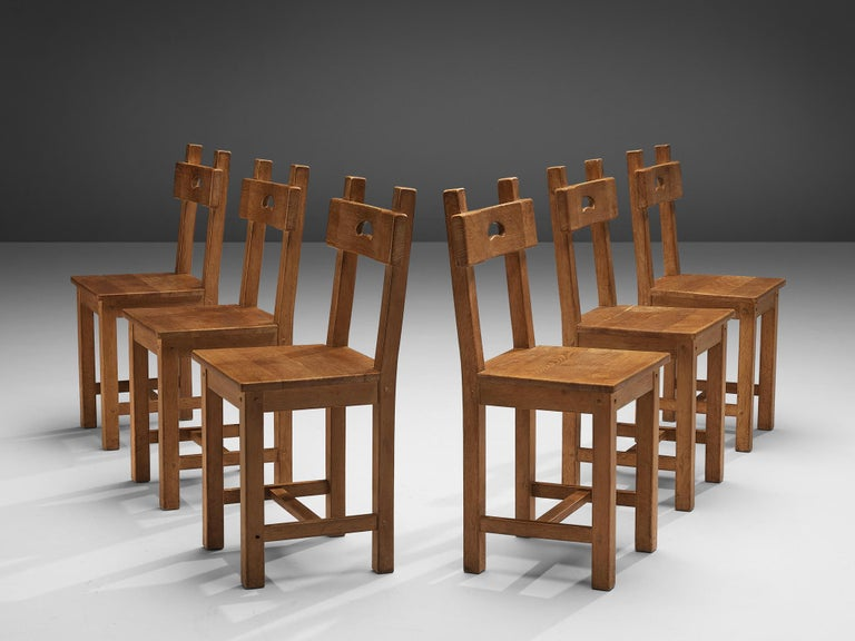 Set of six dining chairs, oak, France, 1950s  Characteristic set of French dining chairs. In absence of decoration the rounded gap in the backrest gets an important visual role as it contrasts with the sharp, angular lines of the frame and seat.