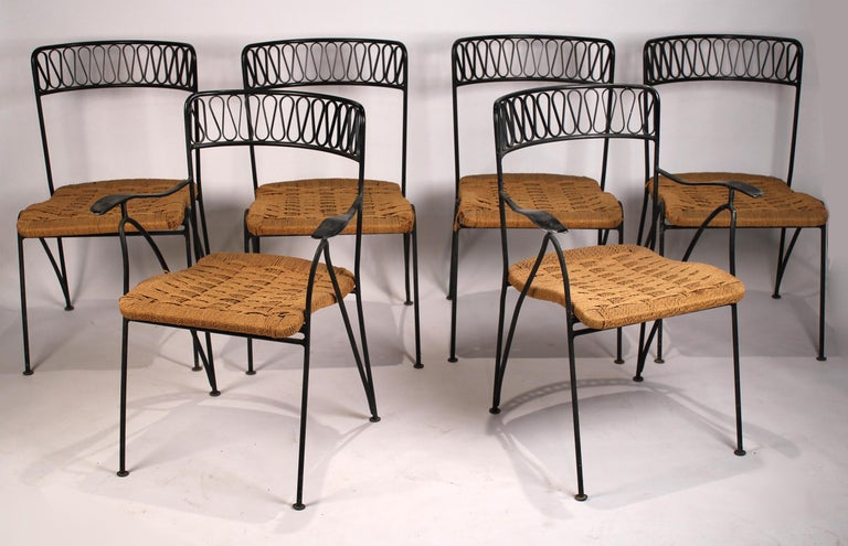 Beautiful set of six Salterini chairs designed by Maurizio Tempestini for Salterini made in Italy. The set is comprised of two-arm and four side chairs with the original paper cord seats. All are in good original condition, some retain the hanging