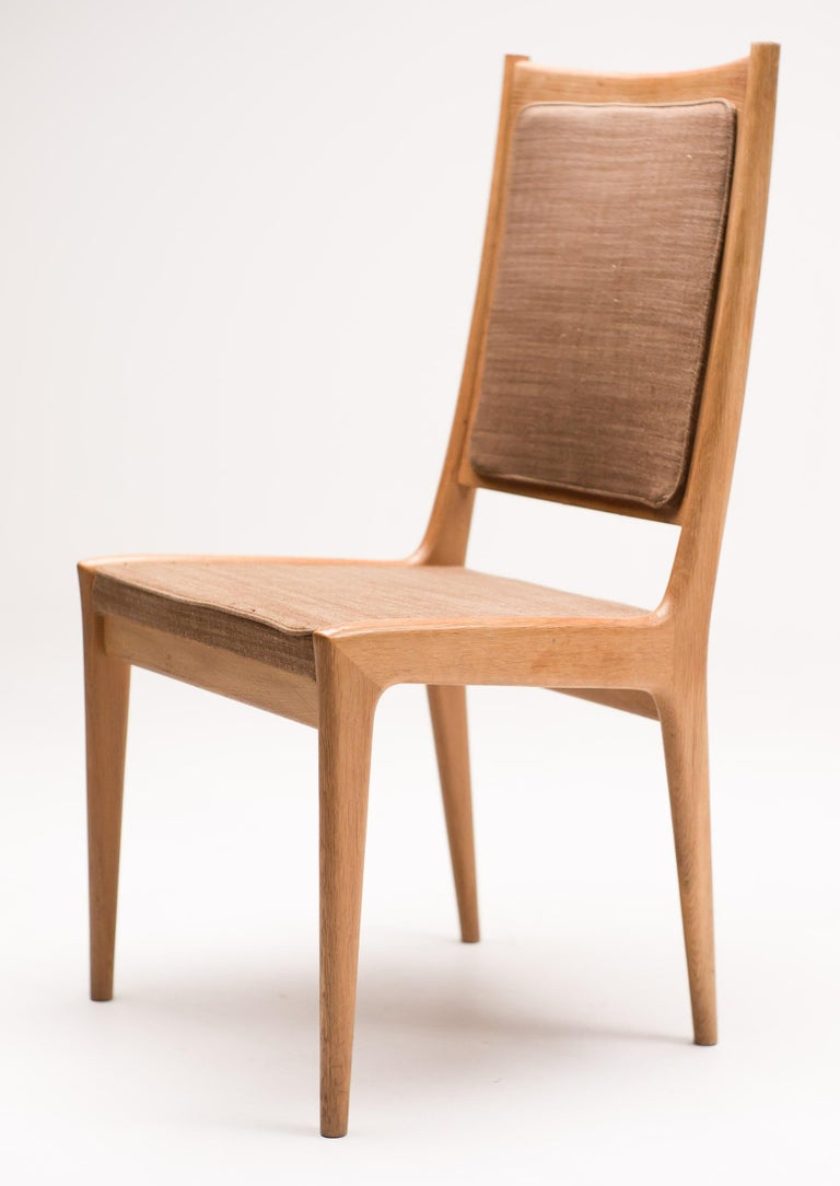 Elegant set of six dining chairs designed by Karl Erik Ekselius for JOC. Artisanal sculpted teak frames with the original light brown fabric.  The original foam was completely deteriorated, and was carefully replaced with new foam by our