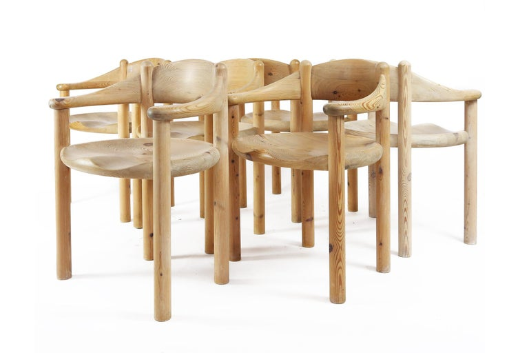 Wonderful set of six very sculptural dining room chairs in pine wood by Swedish designer Rainer Daumiller, manufactured by Hirtshals Savaerk in Denmark. Notice the beautifully carved organic lines of the seats and the general natural feel of the