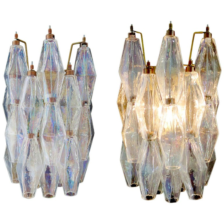 100% handmade in Murano. The sconces are made by 16 Murano handmade Poliedri glass, for each one, in a solid metal frame gold painted and brass. The glasses are now unavailable, they have the particularity of reflecting a multiplicity of colors,