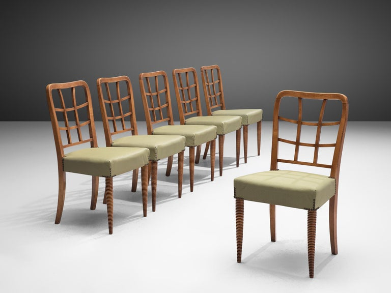 Set of 6 dining chairs, beech and leatherette, Italy, 1950s  This set of dining chairs is both sculptural and well-constructed. The elegant back shows an open frame with a grid that follows the tapered lines of the backrest. The front legs have a