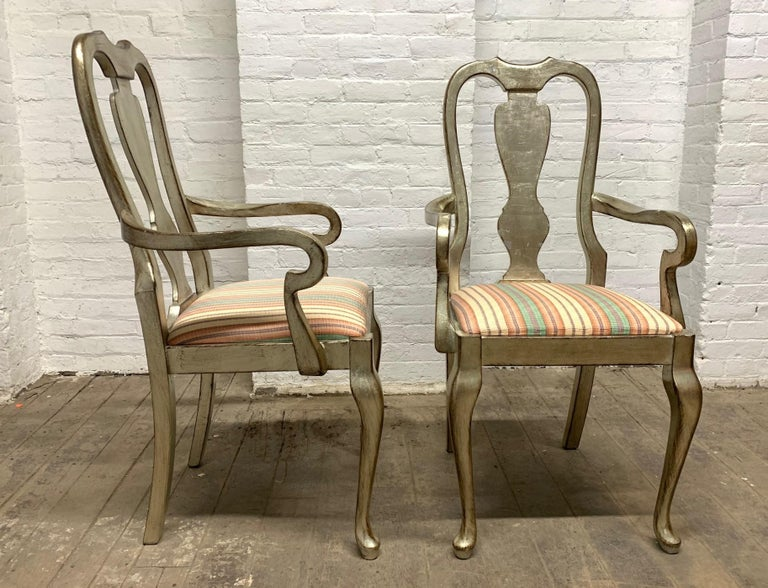Set of six silver leaf / gild dining chairs. Chairs are solid wood, have cabriole legs, sticker says made in Italy with original fabric. 