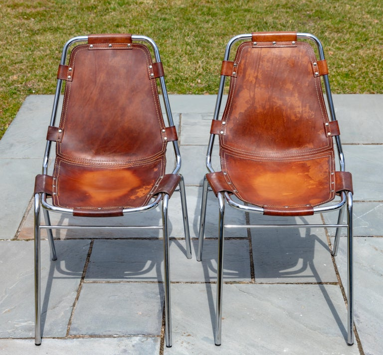 Set of six stacking leather and chrome chairs.