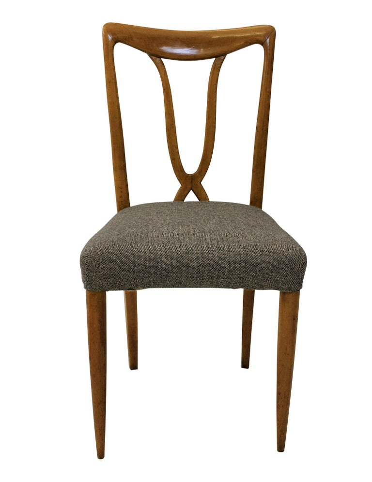 A set of six Italian dining chairs of stylish design in cherrywood. With sculptural backs and newly upholstered in wool.