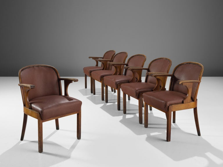 Set of six chairs, oak, brown faux leather, Sweden, 1940s  This set of six dining chairs with original leather upholstery is made by a Swedish cabinetmaker. The chairs have a solid oak frame, tapered legs. The central feature of this design are the
