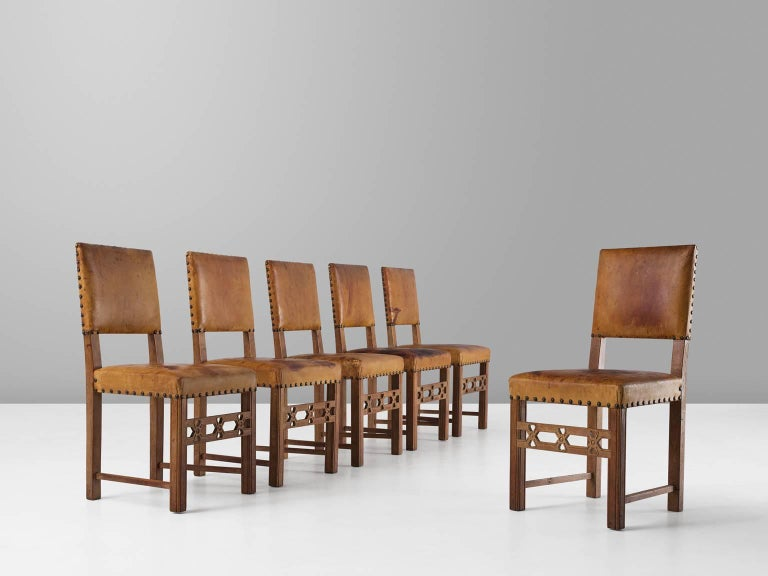 Set of six dining chairs, in oak and leather, Sweden, 1940s.  Set of six elegant dining chairs in oak and expressive patinated cognac leather. These chairs have a straight and simplistic design. Elegant details make these chairs into the unique