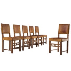 Set of Six Swedish Dining Chairs in Oak and Patinated Cognac Leather