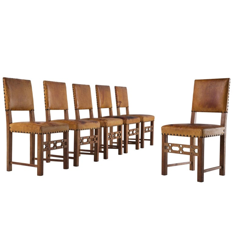 Set of Six Swedish Dining Chairs in Oak and Patinated Cognac Leather For Sale