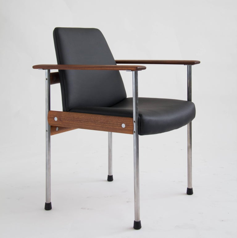 "This is the third iteration or ""3001"" series of Dysthe's popular conference group for Dokka Møbler of Oslo, produced from 1960-1961. The set has six matching chairs with a metal frame, teak crossbars and leather seat and backrest. Includes two"