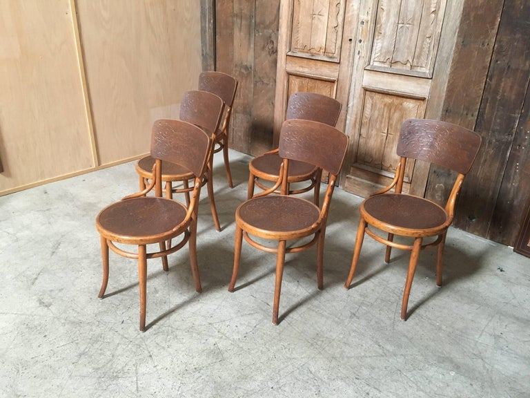 This a great set of chairs with the embossed wood seat and backrest from the famed Thonet plant in Vienna, Austria. They look fantastic in the two-tone finish with great patina.