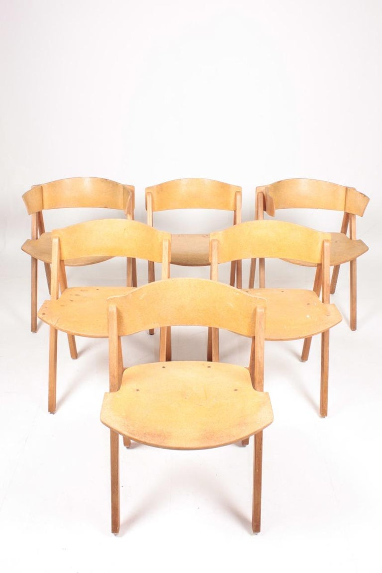 Set of six side chairs in ash tree and cork. Designed by Bernt Petersen. Original condition, 1970s.