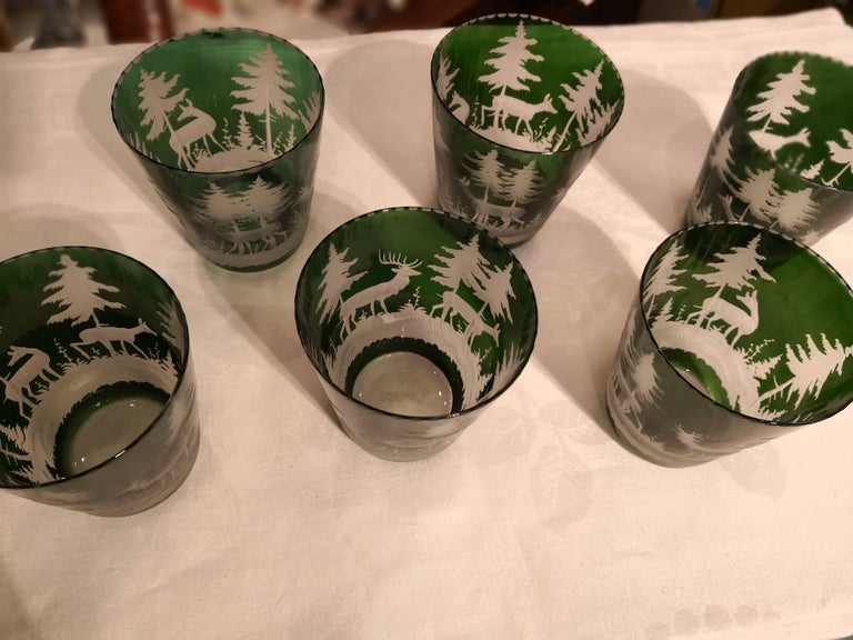 Set of six handblown green crystal tumblers with hand-edged hunting scene. The decor is an antique decor with deers, trees and bambis all around. Completely handblown and hand-engraved in Bavaria Germany. The glass here shown comes in dark green and