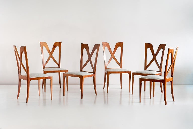 This exceptional set of dining chairs was designed by Don Ulderico Carlo Alberto Forni for a private residence in Milan. The design was produced by hand by a master carpenter in the Como area in the late 1940s.  The frame of the chair is in solid