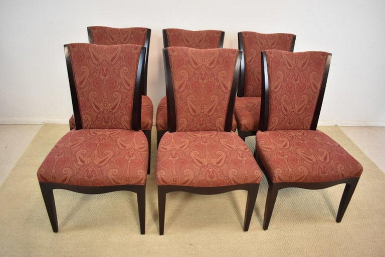 A beautiful set of six dining room chairs by Barbara Barry for Baker Furniture. They feature an espresso finish with a burgundy paisley fabric. The dining room table pictured is available under a separate listing. The dimensions are 22.5