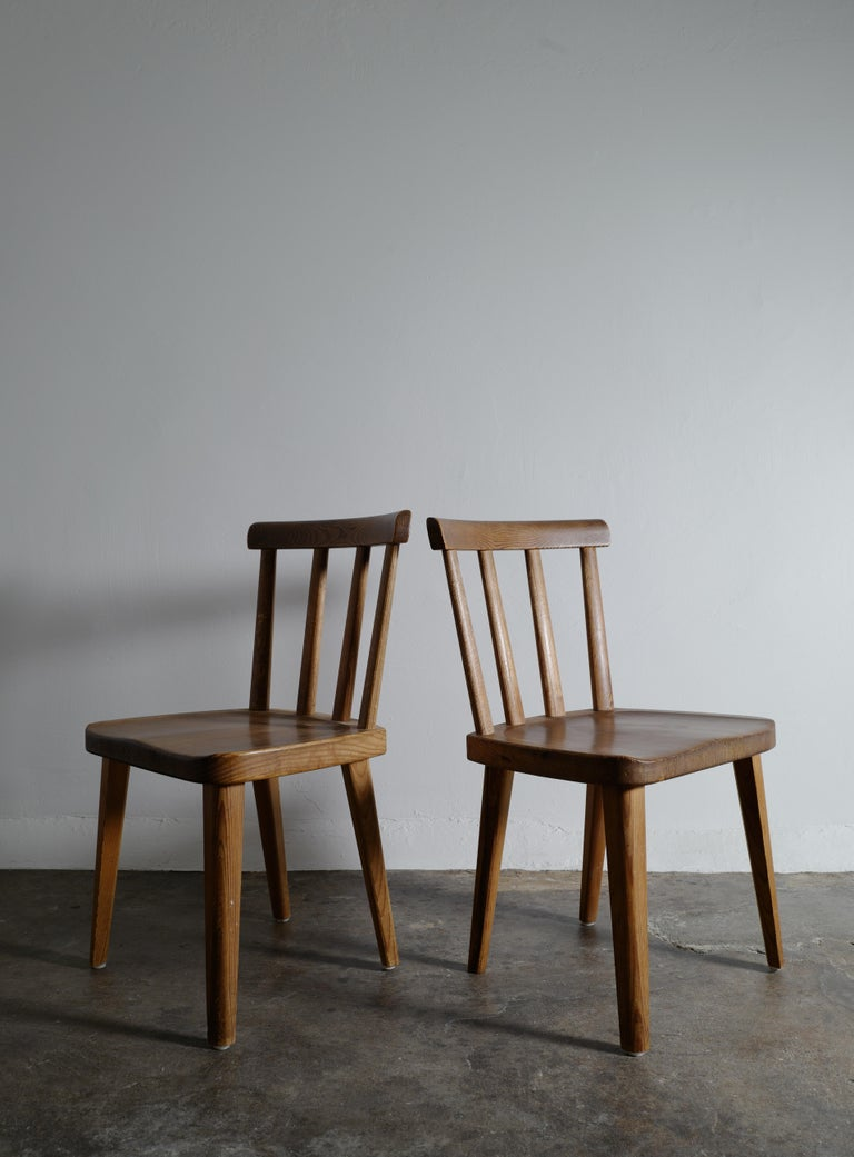 Rare set of six chairs in original condition designed by Axel Einar Hjorth for Nordiska Kompaniet Stockholm during the 1930s. All chairs are in great condition and stable. Showing beautiful patina and signs from use.
