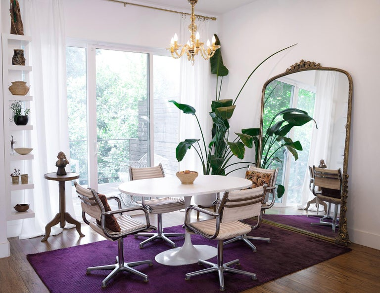 Olymp is a German-based company that specializes in designing hair salon furnishings. The six vintage armchairs are made of polished chrome metal with salmon pink vinyl seats. The chairs have curved armrests and rest on a five-foot pedestal base.