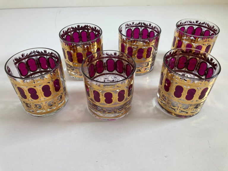 Elegant vintage midcentury Culver barware glasses with Valencia pattern in a gold leaf finish.