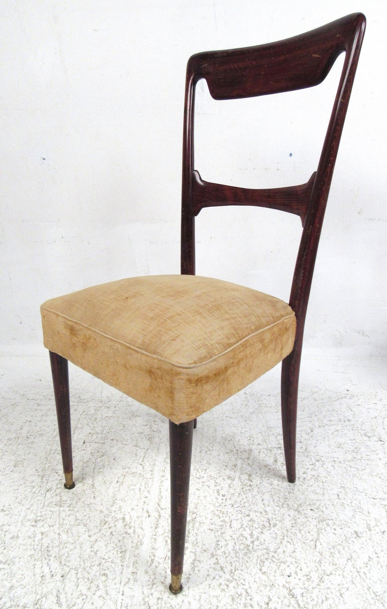 Elegant set of mahogany dining chairs with thick upholstered seats and tapered legs with brass sabots. Please confirm item location (NY or NJ) with dealer.