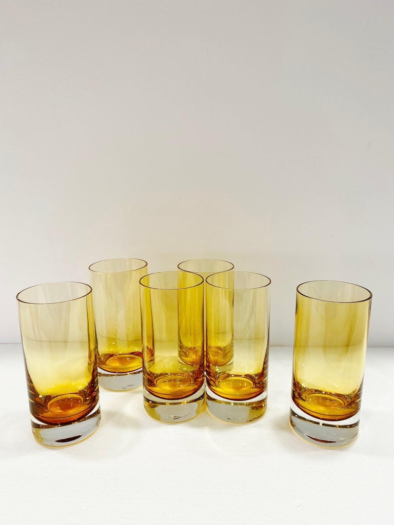 Set of six Mid-Century Modern hand blown Murano barware or dinnerware glasses. Sommerso cased glass design in yellow amber over clear glass. Exquisite design in heavy weight glass. Makes a chic addition to any barware or tableware set.