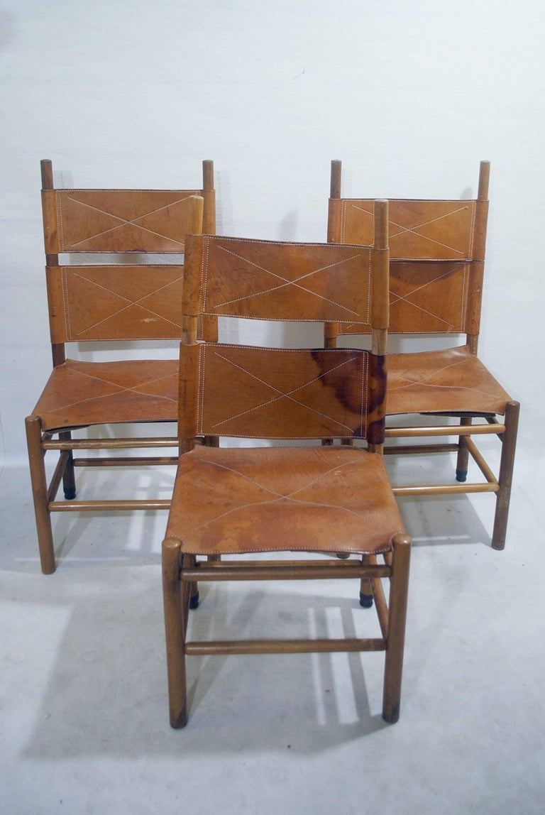 Set of six walnut and cognac leather chairs by Carlo Scarpa for Bernini, 1977.