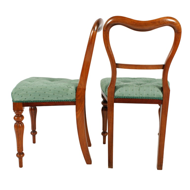 A set of six mid-19th century Victorian walnut dining room chairs.  The chairs have a serpentine top rail, a concave centre rail, the front legs are tapering and reeded.  The chairs have a serpentine shaped to the front and have recently been