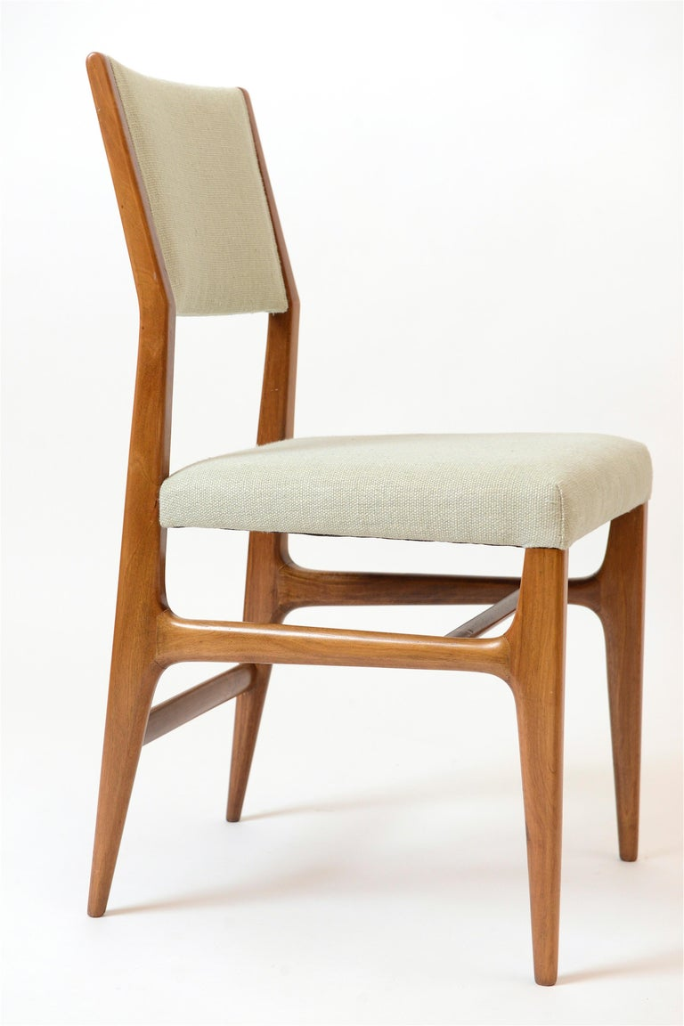 A rare set of six dining chairs designed by the Italian architect and designer, Gio Ponti. Upholstered in a light blue textured fabric, this '602' model was produced by Cassina in the 1950s and is a variation on Ponti's legendary 'Leggera' design.