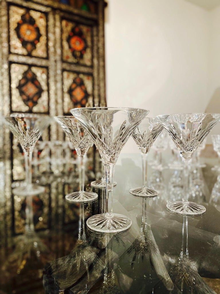 Set of six vintage luxury crystal tall martini glasses from Waterford Crystal. The Lismore Collection is perhaps Waterford's most distinguished design featuring hand blown crystal with the pattern's signature diamond and wedge cuts. First introduced