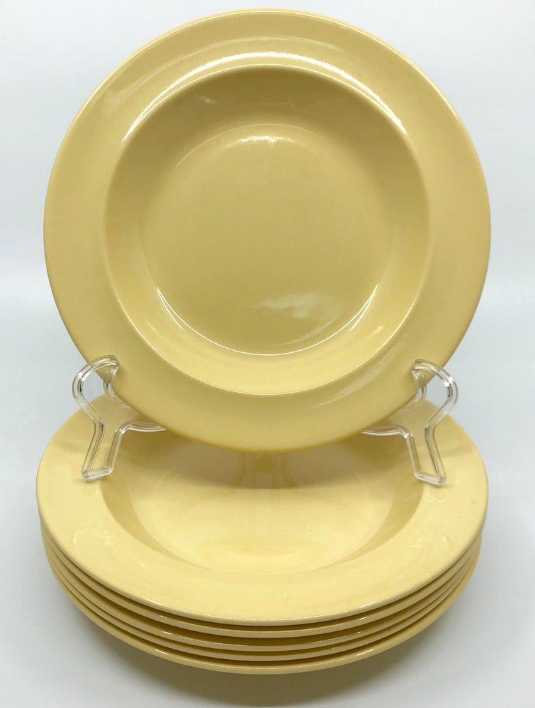 Set of six Wedgwood yellow plates. Six vintage creamware shallow bowls/plates in