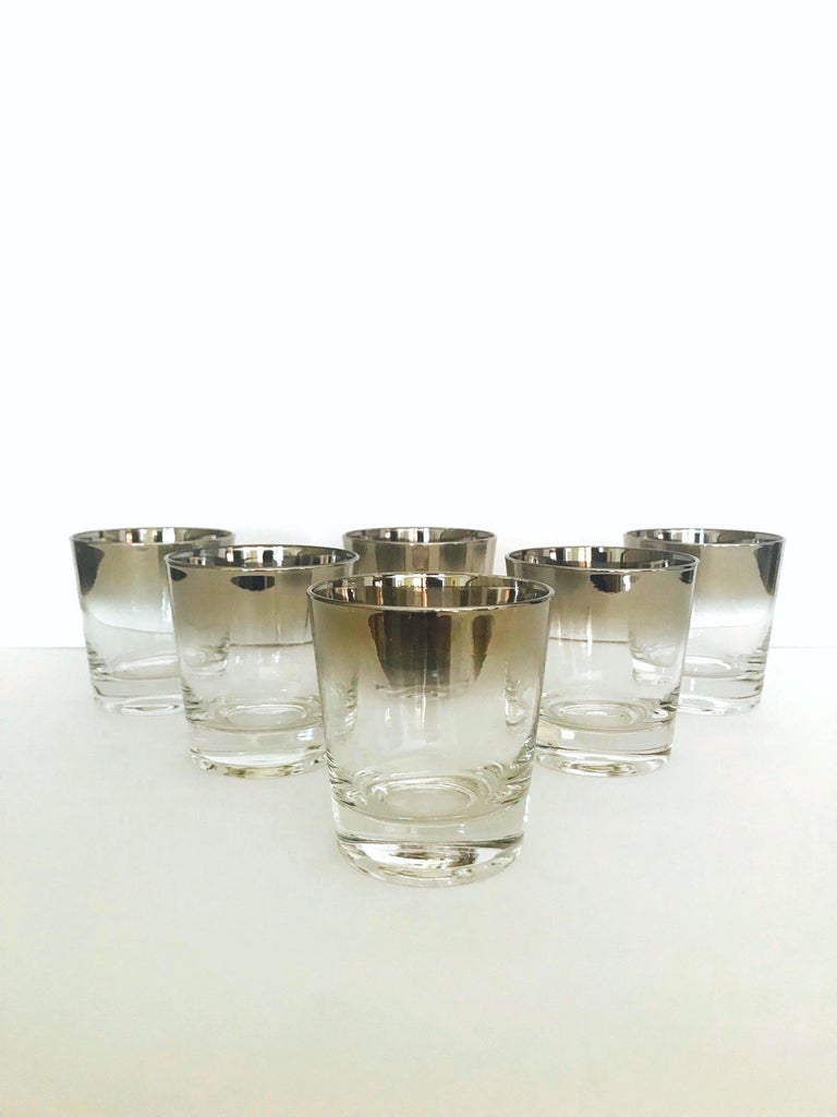 Iconic Mid-Century Modern barware set with silver fade overlay design. Great looking rock glasses with tapered forms and gradient hues of gunmetal along the rims. Set conveniently includes an extra glass for an actual set / 7. Matching martini