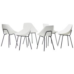Set of Six White Pierre Guariche Chairs