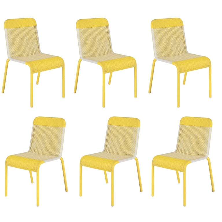 Set Of Six Yellow Resin Stackable Chairs For