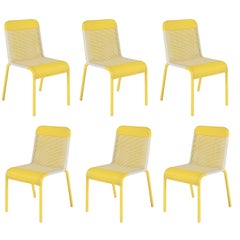 Set of Six Yellow Resin Stackable Chairs