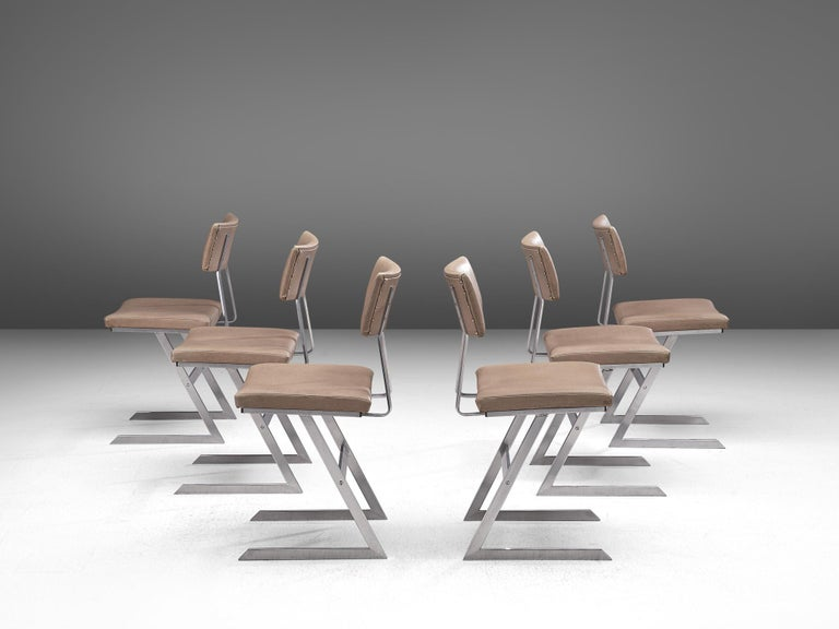 Set of six dining chairs, chromed steel and grey to taupe faux leather, Europe, 1960s.   This set of 6 chairs feature an open construction by means of the Z-shaped frame. The back and seating are made from leatherette. The comfortable back and