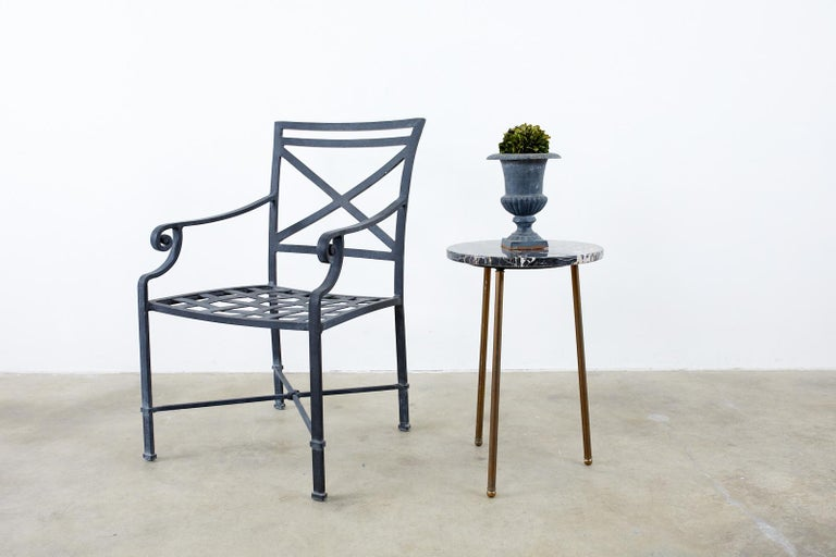 Large collection of sixteen aluminum patio and garden dining armchairs by Brown Jordan. The armchairs are made of wrought aluminum with a multi-step powder coated finish. The black finish has very faint silver and gold flecks on the finish. Known as