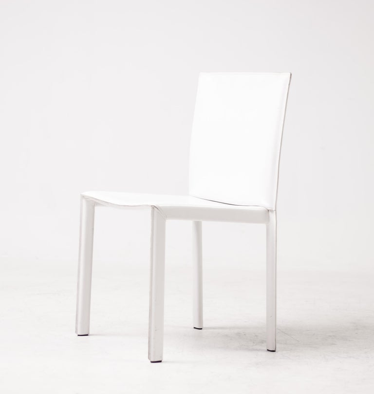 Gorgeous set of 16 Enrico Pellizzoni Pasqualina chairs designed by Grassi & Bianchi. These chairs are covered in wonderful white all grain leather. The chairs were purchased in 2010 and are meticulously maintained. They are in excellent condition