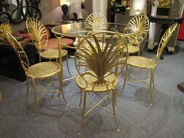 Rare set of 1960s Italian table and six chairs with elaborately detailed backs, in the design of a sheaf of wheat. Raised on gorgeous slim legs with X stretchers, Classic Italian gilt gold finishing. Made by S. Salvadori, Firenze, circa 1960.  The