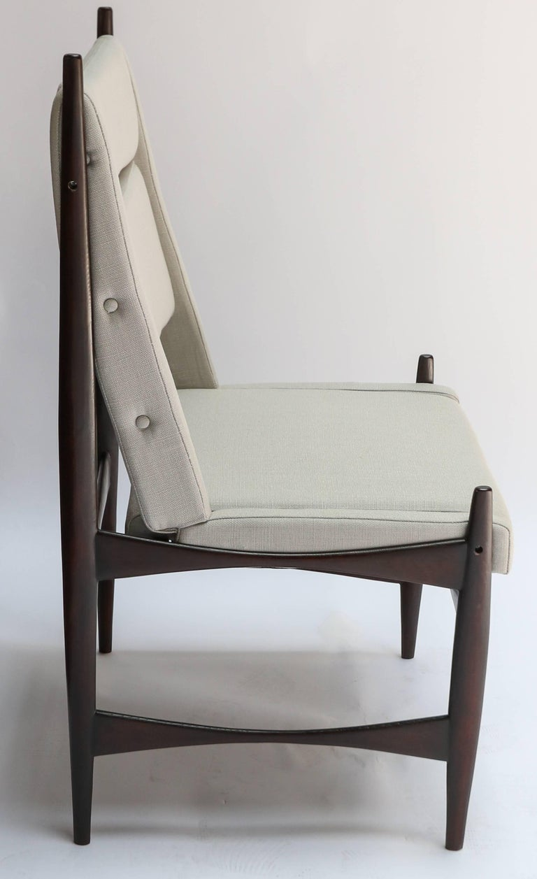 Set of ten midcentury Brazilian wood dining chairs uniquely upholstered in grey/beige linen.