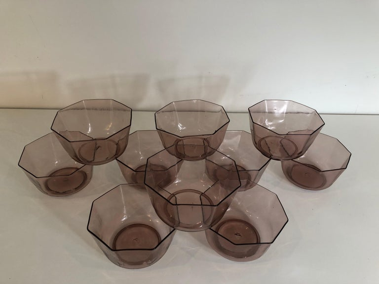A set of ten amber Venetian glass bowls or cups. Matching set of plates also available.