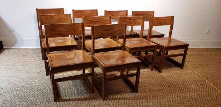 A very handsome and sturdy set of 10 dining chairs. Made from oak and extremely sturdy. These would also be great in a conference room. Clean modern and comfortable.