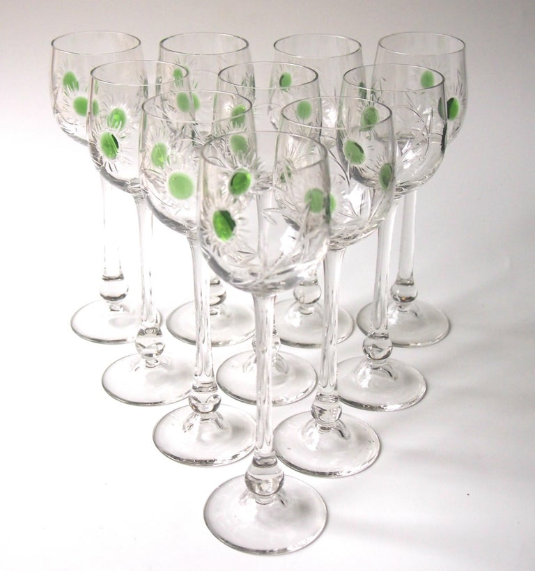 Stunning set of ten Art Nouveau hot applied hand cut crystal hock glasses by the important German maker Jean Beck. Each elegant glass has three hot applied green spots and was then hand cut in a stylised Art Nouveau pattern. One of the most