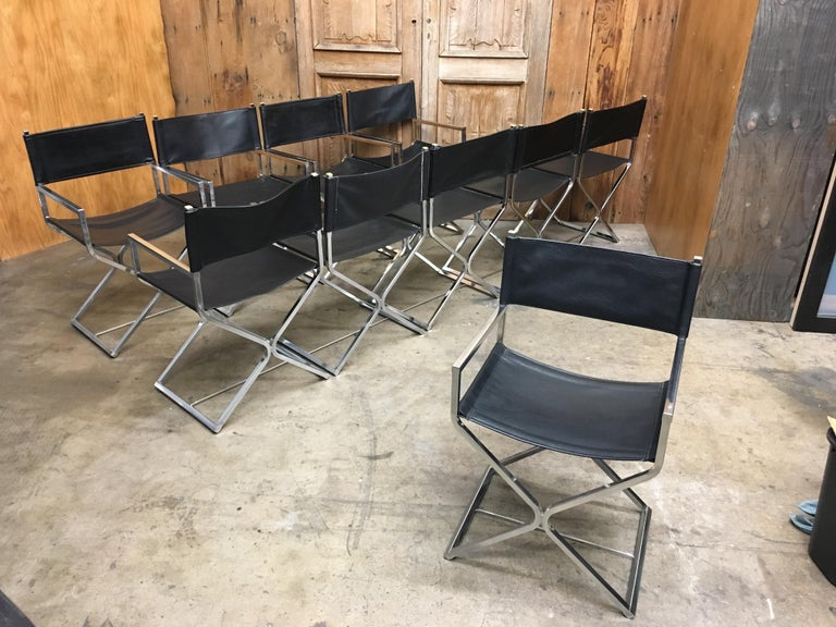 Chrome with vinyl upholstery X-base director style chairs.