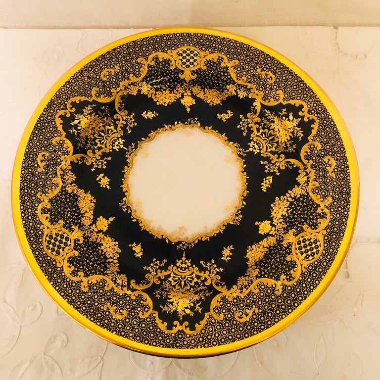 Set of ten cobalt Copeland dessert or luncheon plates with raised gilding on a fluted ribbon border. You can tell that the intricate detailed gilding on these plates has been done by an expert gilder. These plates are special enough to impress all