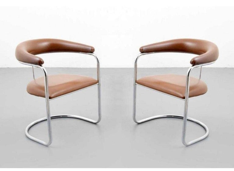 Set of ten armchairs designed by Anton Lorenz for Thonet. Each chair has tan upholstered backrest and seat with polished chrome tubular frames.  Mid-Century Modern S-37 chairs were originally designed by Anton Lorenz in 1929 and later manufactured