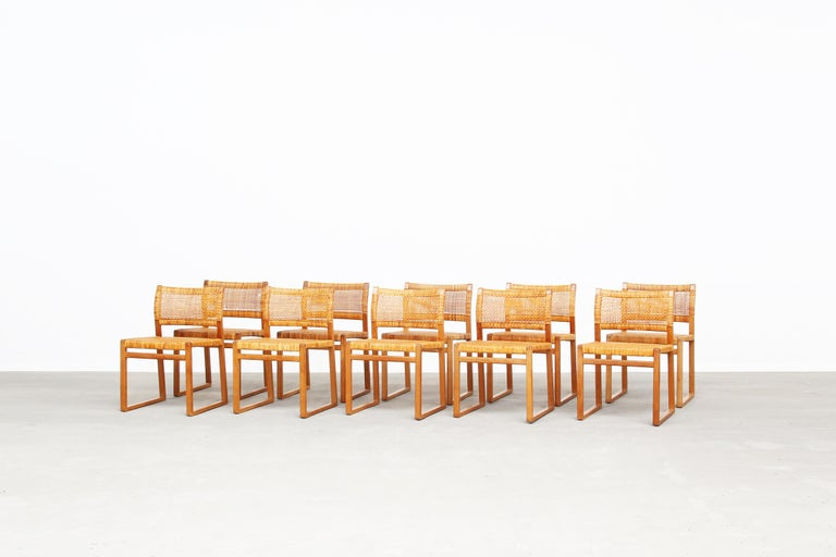 A very beautiful set of ten dining chairs Mod. BM 61 designed by Børge Mogensen for Fredericia Stolefabrik, Denmark. All chairs are in a very good condition with just little traces of usage. The frame made of oak comes in a great patina. The cane is